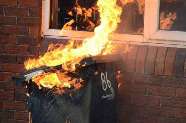 A picture of a wheelie bin fire outside a house