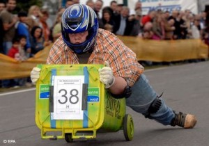 Wheelie bin racer flying down hill