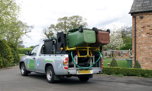 Wheelie bins being cleaned by professionals